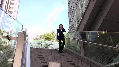 Modern Buildings And Confident Japanese Business Woman Walking Downstairs Footage