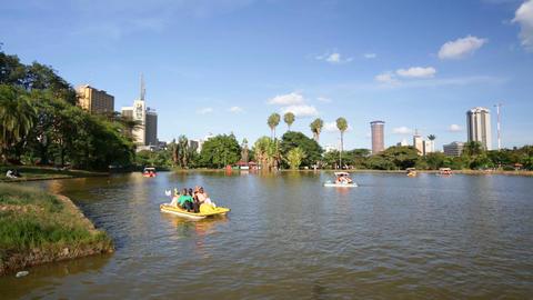 Boats On Uhuru Lake And Nairobi Skyline, Kenya, editorial Footage