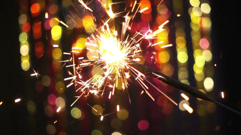 Sparkler On Color Bokeh Background Footage