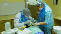 Dentist cleans teeth of woman patient with special equipment Live Action