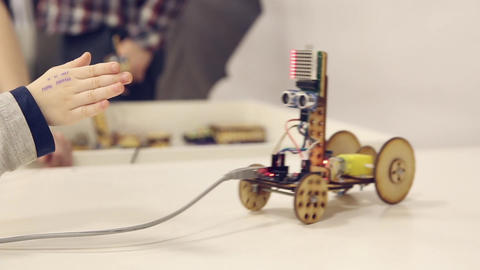 Wooden robot on wheels Footage