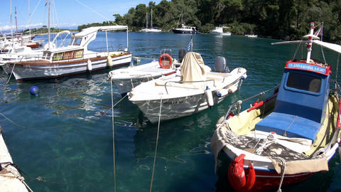 Pleasure boats moored in a seaport surrounded by wooded hills 00 Footage