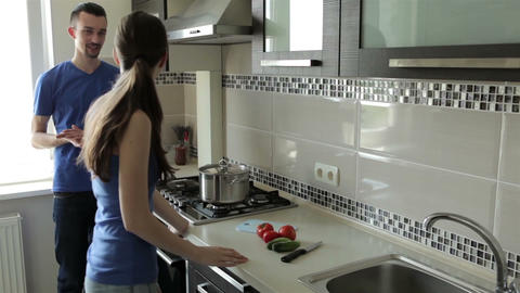 Couple talking in the kitchen Footage