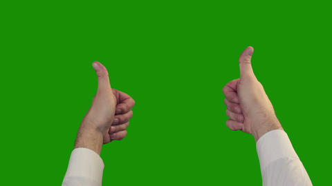 Thumbs up on the green Chroma Key Footage