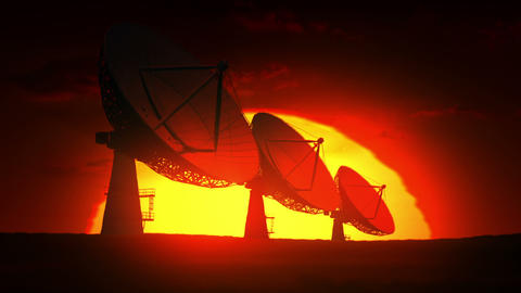 Satellite dishes at sunrise Stock Video Footage