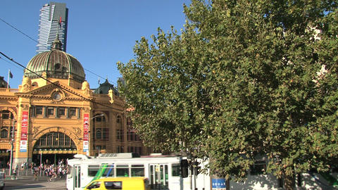 Busy street with people and trams around Flinders station Stock Video Footage
