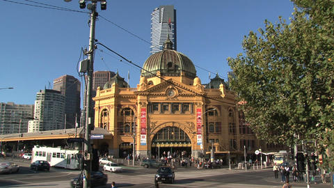 Trams and cars at a busy street around Flinders station Stock Video Footage