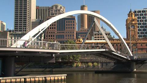 People walking across a bridge Stock Video Footage