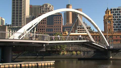 People walking across a bridge Footage