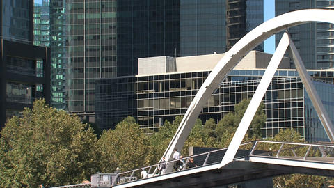 People walking across the pedestrian bridge Stock Video Footage