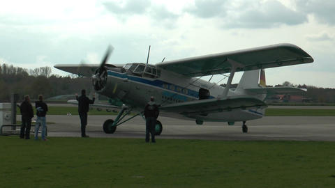 historic antonov an-2 biplane rolling to park position Stock Video Footage