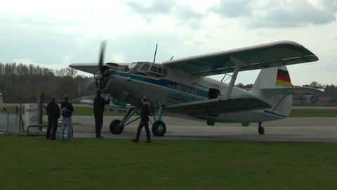historic antonov an-2 biplane rolling to park position Footage