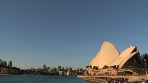 Pan from Sydney Harbour Bridge to the Opera House Stock Video Footage