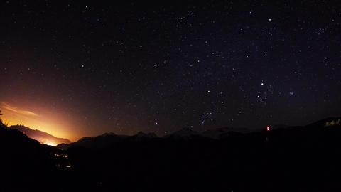 Moon light shinning on snow mountain at night Stock Video Footage