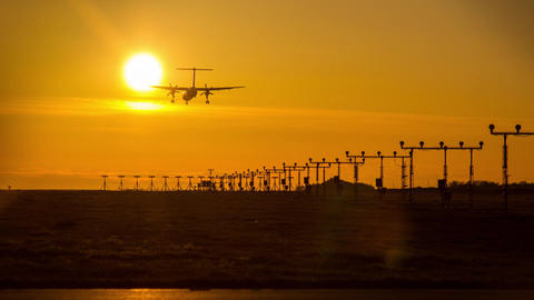 Sunset time at YVR with airplanes landing Stock Video Footage