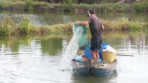 Fisherman pulling in his net Stock Video Footage