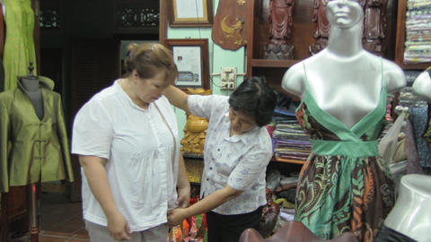 Woman tries on clothes at the tailor Stock Video Footage