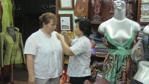Woman tries on clothes at the tailor Footage