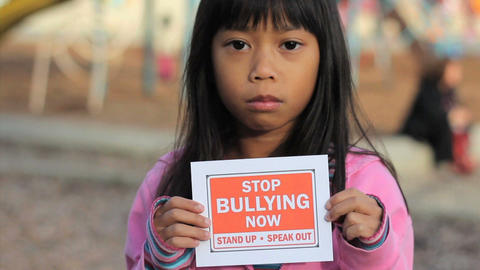 Sad Asian Girl Holds A Stop Bullying Sign Footage