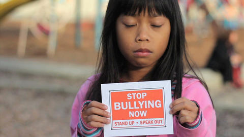Sad Asian Girl Holds A Stop Bullying Sign Stock Video Footage