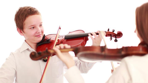 Two Teenager Playing The Violin stock footage
