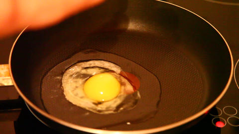 Eggs fried in a pan Footage