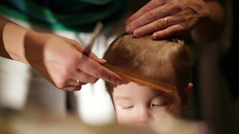 The little boy's hair is being cut Stock Video Footage