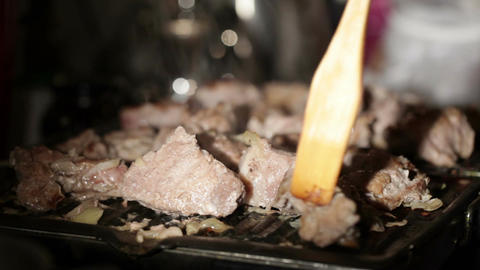 Nice pieces of meat are fried on the barbecue Stock Video Footage