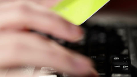 Holding a credit card and typing Stock Video Footage