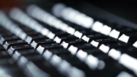 Typing on the keyboard at night Stock Video Footage