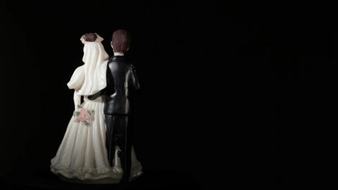 Wedding cake figurines rotation on black Stock Video Footage