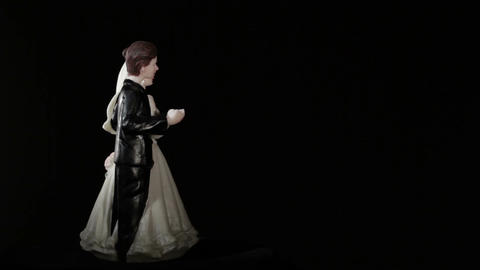 Wedding cake figurines rotation on black Stock Video Footage