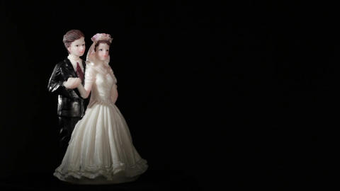 Wedding cake figurines rotation on black Footage