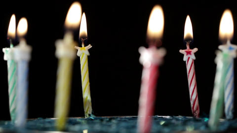 Candles rotation on black background Stock Video Footage