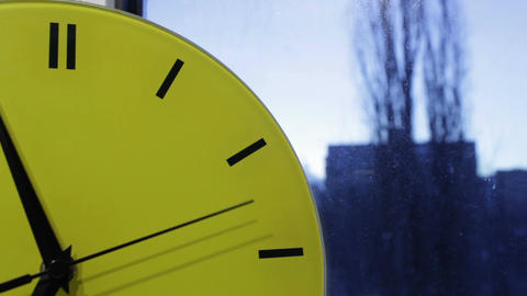 Yellow clock and the city. Time lapse Stock Video Footage