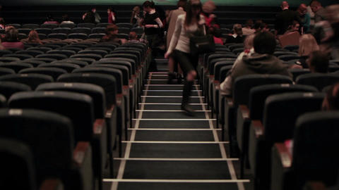 Audience fills the theatre. Defocused people shot from... Stock Video Footage