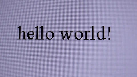 Hello world. Macro shot with flying and bluring words Stock Video Footage