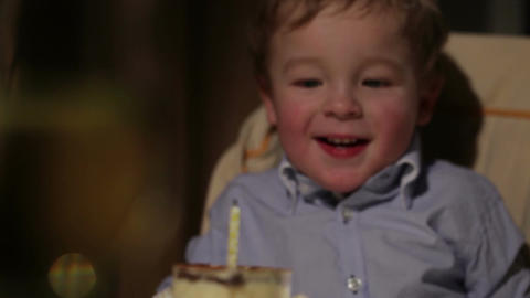 Kid's birthday. Boy blows out the candle Stock Video Footage