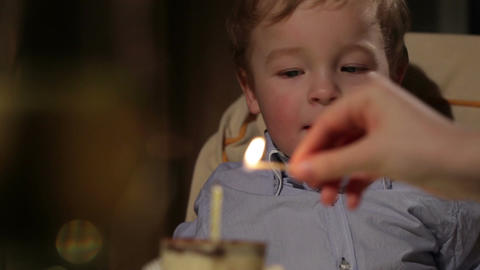 Kid's birthday. Boy blows out the candle Footage