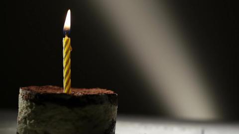 One candle in tiramisu cake. Birthday vintage background Stock Video Footage