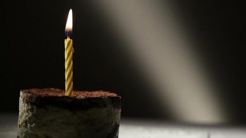 One candle in tiramisu cake. Birthday vintage background Footage