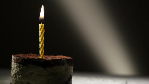 One candle in tiramisu cake. Birthday vintage background Stock Video Footage