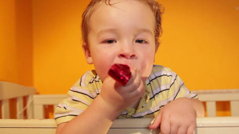 Portrait of the boy playing in the playpen Footage