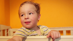 Portrait of the boy playing in the playpen Stock Video Footage
