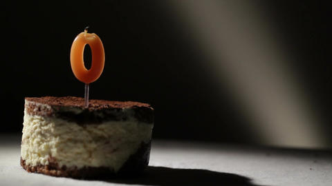 Candle o in tiramisu cake Stock Video Footage