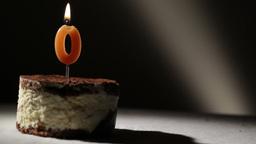Candle o in tiramisu cake Stock Video Footage