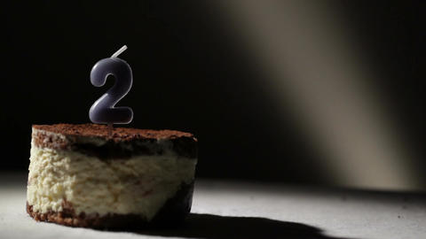 Candle two in tiramisu cake Stock Video Footage