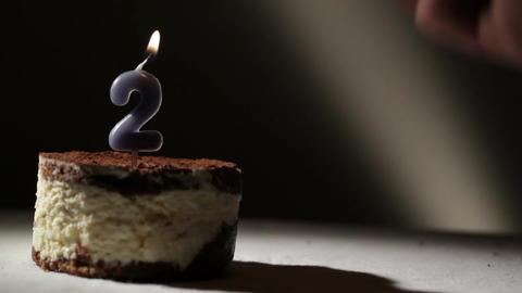 Candle two in tiramisu cake Stock Video Footage