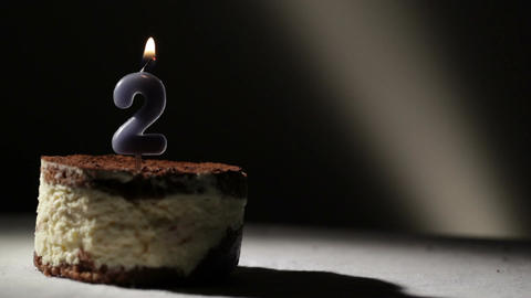 Candle two in tiramisu cake Footage