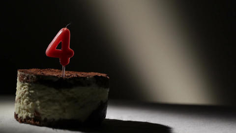 Candle four in tiramisu cake Stock Video Footage